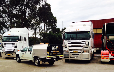 A mobile unit and two K&C trucks being serviced